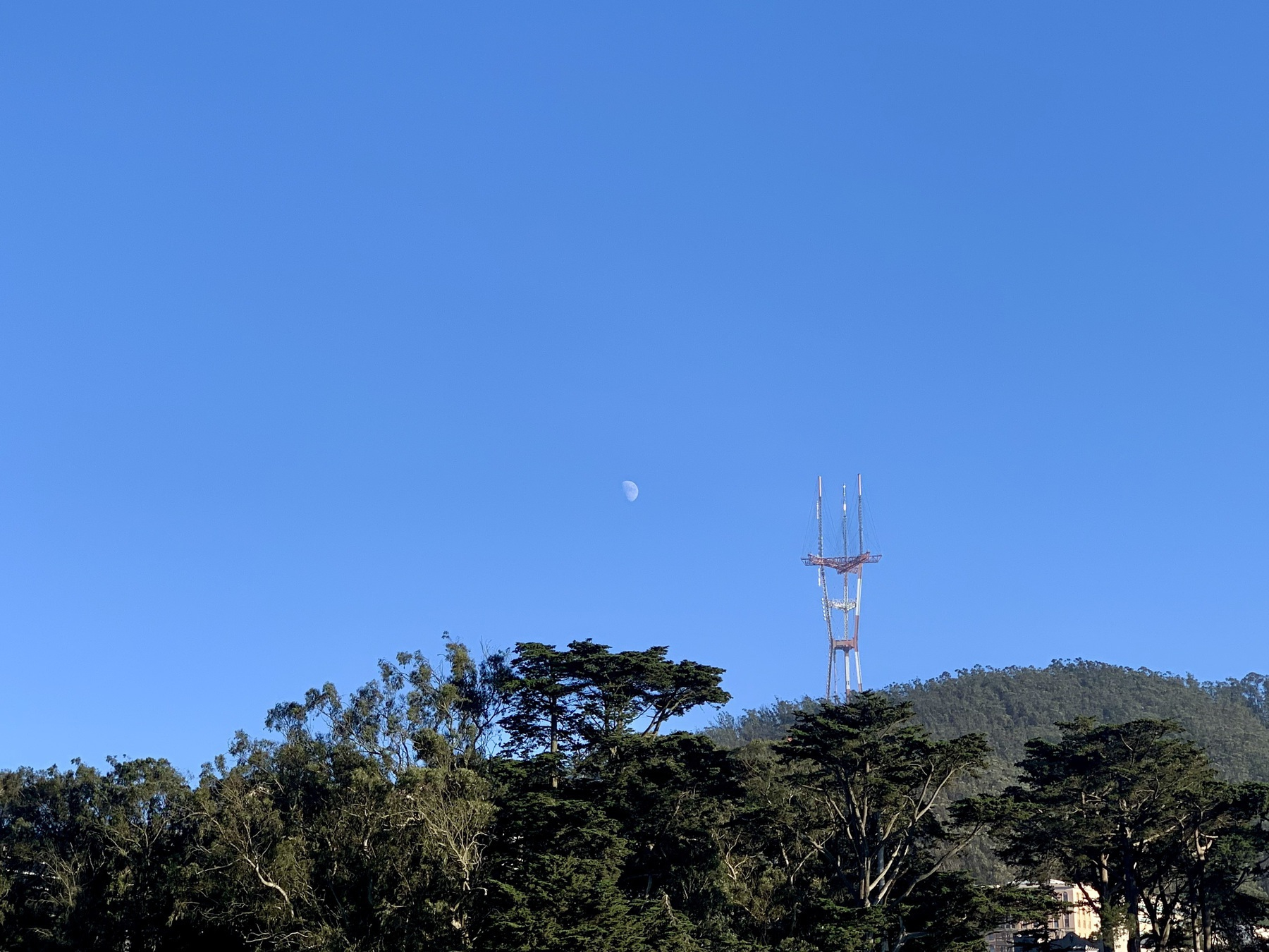 Photo of the sky over San Francisco showing first quarter moon and Sutro Tower